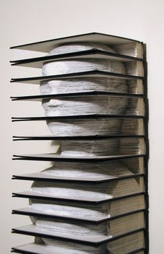 Brian Dettmer sculpts books into art