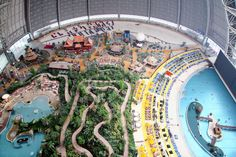 Tropical Islands Resort in Germany-the world's largest indoor rain forest and is an enormous waterpark to boot!  You can rent tents and stay overnight.  This is my kiddo's dream vacation.