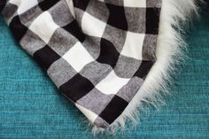 ok- i pinned this mostly for the great sewing annd cutting fur tips in this tutorial. check them out!  but of course a fabric backed fur is a nice blankie~    Faux Fur + Flannel Blanket DIY