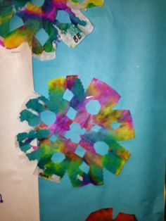 Beautiful colorful snowflakes made with liquid watercolors and coffee filters.