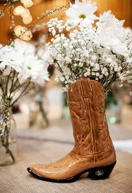 This is a brilliant centerpiece idea...can be cheap with cowboy boots from thrift stores n some shoe polish?