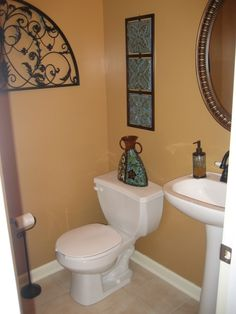 Small Half Bathroom half bath on a budget love color, chair rail, photos ontop of each