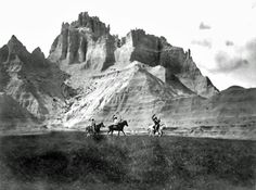"""Image called """"Entering Bad Lands"""" showing a Sioux War Party. It was taken in 1905 by Edward S. Curtis. (B&W copy)"""