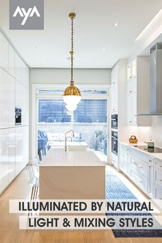 Illuminated by natural light this beautiful transitional kitchen in AyA's Medio Latte and Shale painted doors is paired with sleek, white high gloss slab doors. A bright and brilliant kitchen with brass hardware and details. Visit our gallery at ayakitchens.com for more kitchen ideas. Brass Kitchen, Kitchen Cabinetry, Kitchen And Bath, New Kitchen, Kitchen Ideas, Kitchen Design, Slab Doors, Kitchen Gallery, Transitional Kitchen