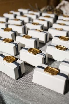 Favor Boxes with Gold Wax Seals | Photography: Perez Photography. Read More: http://www.insideweddings.com/weddings/incredible-tented-ceremony-barn-reception-at-ranch-in-aspen/860/