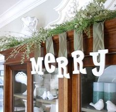 Next, my littlest ones helped paint and glitter up some very merry MDF letters found at a craft store. I stapled ribbon to the back and suspended them in our dining room area, how fun!  You can't quite tell in the photo, but the white glitter adds more sparkle in the light.