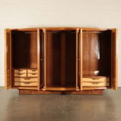 For Sale on 1stdibs - Wardrobe with swing doors; burl veneered wood with polyester finishing and mirror. Good conditions, shows small signs of wear.