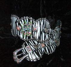 Zebra background with crown and roses with Swarovski crystals conchos.