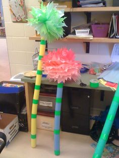 I made Truffula trees with duct tape, pool noodles and tissue paper for our Dr. Seuss themed preschool graduation.