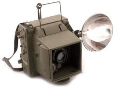 Graflex Combat Graphic 45 with a 1944 dated lens and rare canvas neck strap attached to the top. This is a late- 1945 to post-war model with bayonet type flash. Aerial Camera, Photo Lens, Camera Equipment, Camera Gear, Vintage Cameras, Graphic 45, Digital, Interesting Stuff, Wwii