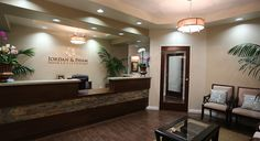 Logo option. Textured front desk. Nice wall color