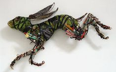 'Bounding Hare' wall mounted creature made with a wood and plaster armature over which strips of textiles and wire were wrapped around. Knitting needles and typewriter keys for legs