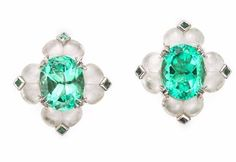 Earrings set with Oval Shape Colombian Emeralds, Diamonds and eight pieces of white jade.