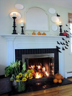 This web site has a dozen awesome Halloween fireplace mantels.  Look at this fireplace insert...
