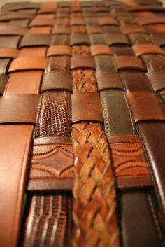 Old belts can be refashioned into a woven belt bench. Begin weaving using three belts. Continue the under and over pattern until all the belts are used and the bench is large enough to place on the frame.