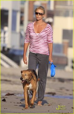 Ms. Charleze Theron walking her canine on the beach...