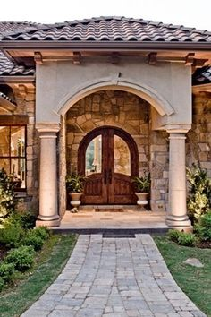 Spanish style house copper accents tile roof light for Mediterranean style front doors