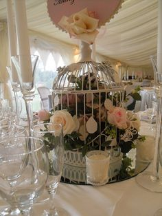 Birdcages filled with Roses