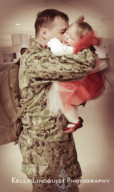 "Example Of Military Homecoming Photo Session by Kelly Lindquist Photography For Charity!  I call this ""First Hug at First Sight"".  Daddy is home!"