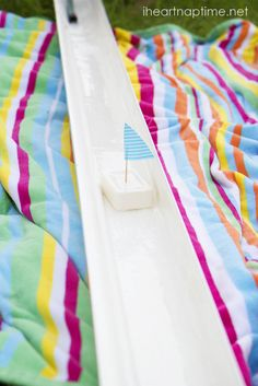 Use a rain gutter to race soap boats. This would be a fun activity for the kids this summer.
