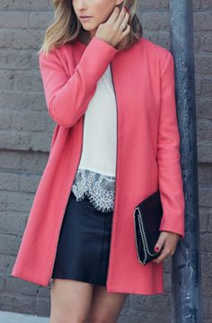 Pairing a sleek leather mini skirt with a lace top, and colorful jacket for an edgy feminine fall look.