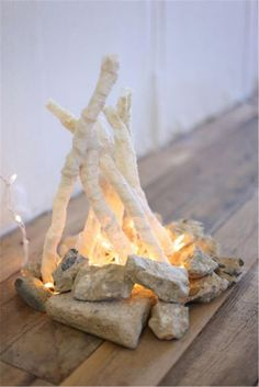 DIY Lace Twinkle Lights Flameless Fire Pit - I LOVE, LOVE, LOVE this idea! I think I will try it with painted white twigs and a coat of sparkle instead of going through the hassle of the lace cast ❤ Lagerfeuer Fake Fireplace, Fireplace Kitchen, Fireplace Shelves, Fireplace Outdoor, Black Fireplace, Fireplace Mirror, Concrete Fireplace, Christmas Fireplace, Fireplace Hearth