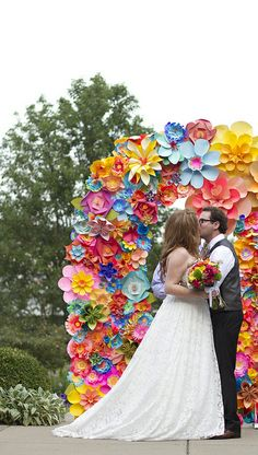 Paper flower arbor, arch, backdrop for wedding ceremony. My very favorite part of our wedding decor. Stephanie and Daniel by eatpomegranate, via Flickr