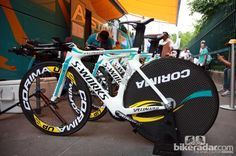 Astana's Specialized S-Works Shiv time trial machines are striking in their white, blue, and yellow livery.