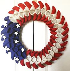 With this wreath you display how proud you are to be an American! Hang for the Fourth of July, Memorial Day or year round! Made with burlap - very light. Secured on a styrofoam wreath and comes with mounting instructions and hardware. Measures approximately 16x16 and is ready to hang.