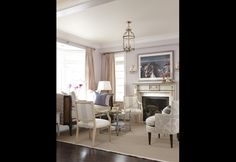 Sarah Richardson: Sarah used the long, thin living room to create two separate seating areas — one just off the kitchen and one in front of the fireplace. Living Room Seating, Formal Living Rooms, Home Living Room, Living Room Furniture, Living Spaces, Modern Living, Sarah Richardson, Pastel Living Room, Suburban House
