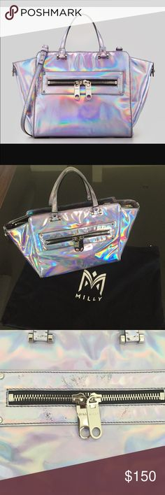 """Milly Holographic Demi Tote LOWEST PRICE MISSING SHOULDER STRAP - SOME SIGNS OF WEAR.  Never misplace your handbag again with this Milly holographic mini tote bag. A trapezoidal silhouette and hardware detail show the world your modern sense of style. Hologram leather with silver hardware. Rolled tote handles with bar detail; 4"""" drop Trapezoidal body. Front zip pocket with oversized tassel pull tabs. Extended zip top. Faille lining; one zip and two open pockets. 10 3/4""""H x 17""""W x 5""""D; bag…"""