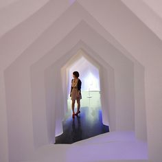 Cut-out profiles of gabled houses formed a tunnel at a university gallery for Japanese architect Kotaro Horiuchi's third paper installation.