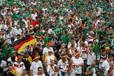 German and Northern Ireland supporters walk together to the Parc des Princes stadium.