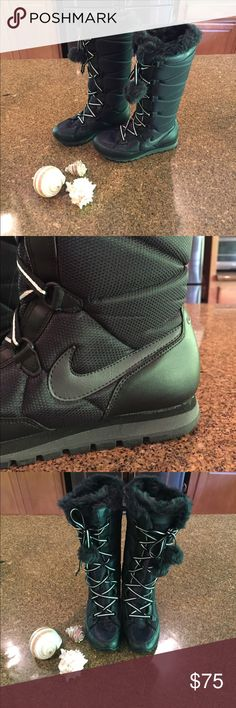 Nike winter boots Bran new perfect condition, never worn! There is one puff ball that has fallen off though other than that awesome pair of boots and stylish too! Nike Shoes Winter & Rain Boots