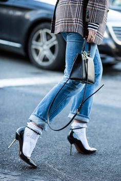 Street style from New York fashion week included this socks with heels combination