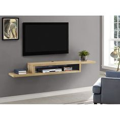 Float the Martin Furniture 72 in. Asymmetrical Wall Mounted TV Shelf below your wall-mounted television for convenient storage of your television component. Wall Mount Tv Shelf, Tv Wall Shelves, Diy Shelving, Wooden Shelves, Glass Shelves, Tv Wanddekor, Shelves Under Tv, Martin Furniture, Tv Wall Furniture