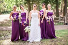 Striking purple bridesmaid dresses with flattering ruching on the bust and waist complement the bride's lovely strapless gown. And jewel tones are always flattering!  Memphis Wedding Photography by Amy Hutchinson Photography. Venue: Club Windward / Flowers: A Garden Secret / Wedding dress: All About Weddings