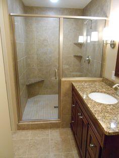 Basement Bathroom Remodel   Emser Cordova Noce Ceramic Tile On The Shower  Walls And Floor With Granite Shower Seat And Corner Shelves, Moen Eva  Brushed ...