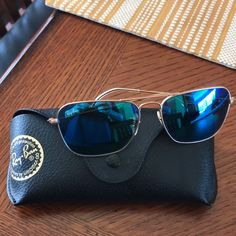 Ray Ban Sunglasses Gently used RayBan Sunglasses with ice Blue mirror lenses Ray-Ban Accessories Sunglasses Ray Ban Sunglasses, Sunglasses Case, Ray Ban Gold, Blue Mirrors, Sunglasses Accessories, Lenses, Ray Bans, Best Deals, Ice