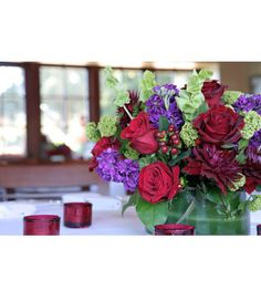 Stock, bells of ireland, vivernum, dahlia, low vase, hypericum berries, salal