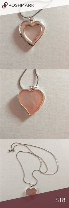 Reversible Pink Heart Necklace Reversible Sterling silver pink heart necklace with pink mother of pearl shell as the inside of the heart. Chain is 24 inches Jewelry Necklaces