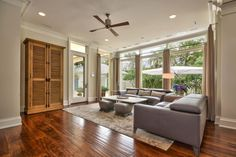 Transitional living room in Tampa featuring hardwood floors and white patterned rug. New Home Windows, Room, Contemporary Living Spaces, Transitional Living Rooms, Home, Living Spaces, Interior Design, Home And Living, Contemporary Furnishings