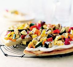 A focaccia spread with goat cheese and cream cheese is the base for this vegetable recipe. Grilled eggplant, zucchini, and red and orange sweet peppers, brushed with a balsamic vinegar mixture, colorfully top the pizza-like main dish.