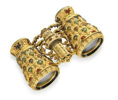 A PAIR OF ANTIQUE IVORY, ENAMEL AND GOLD OPERA GLASSES Designed as a pair of carved ivory opera glasses, decorated with multi-colored enamel floral motifs, with gold and black and green enamel trim, enhanced by sculpted gold foliate detail, circa 1880