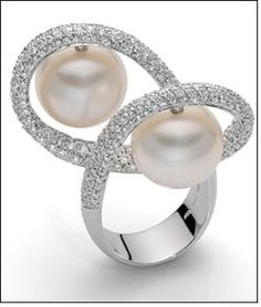 From collection by renowned Italian jeweler, Roberto Coin. Sold by retailer in the Middle East, Damas.     Diamonds AND pearls? Definitely a girl's best friend!