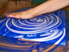 Finger paint. Finger painting isn't just fun for kids– adults can enjoy it as well. Get your hands messy and really have fun spreading paint around.