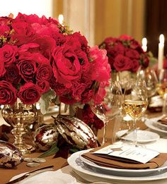Wedding, Flowers, Reception, Red - Photo by Brides.com  (i like the silver holder for the flowers)