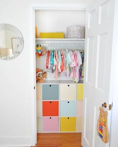 Sure, simple white or wooden bins would have been fine for keeping this kiddo's closet organized. But painting them in cheery hues adds an extra dose of happy to the room — and who can argue with that? See more at A New Bloom »