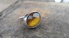 Silver cufflinks with tiger's eyes stone that enhances good luck, and brings prosperity, often in the form of money. Tiger's eye is also a very protective stone which is especially protective during travel.    A doublet stone made with tiger eye and faceted rock crystal
