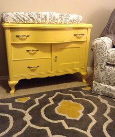 Finished product - antique dresser/changing table painted yellow for Isla's nursery!